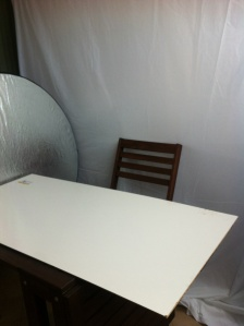 Silver reflector and white board for fill light